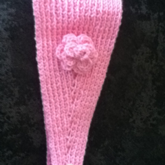 Knitted pink headband with crochet flower