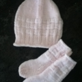 Pale pink knitted socks and beanie