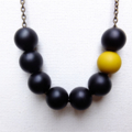 Black Beaded Asymmetrical necklace With Single Yellow Bead Feature