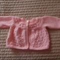 Size 6-12 mths Hand knitted baby jacket or cardigan in pink by CuddleCorner