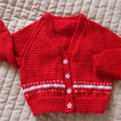 Size 6-12 months: Girls hand knitted cardigan in red and white by CuddleCorner