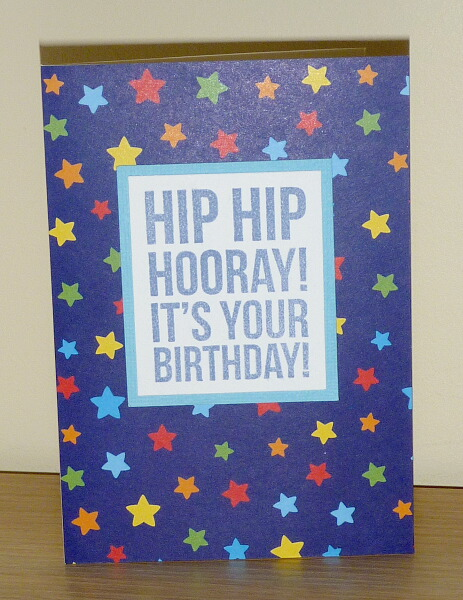 Paper with hand stamped hip hip hooray it s you birthday greeting
