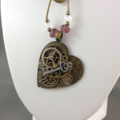 Steampunk Inspired  Mechanical Heart Pendant on Crystal and Pearl Long Necklace
