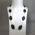 Matte onyx beads on a long  silk necklace