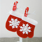 Christmas mitten decoration in red with white snowflake, tree decoration