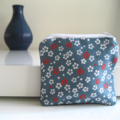 White and red floral print coin purse with black denim back
