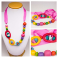 Necklace, Pink Ribbon, Multi Coloured resin beads - red, green, pink, yellow.