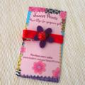 Lucky Ladybird on dark purple flower clip