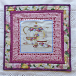 Set of 2 mats (table or trivet)  Pink with tea cup design