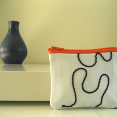 Orange, blue and white patterned lined coin purse