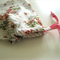 Pink, white, green floral satin drawstring bag with double dotted stripe feature