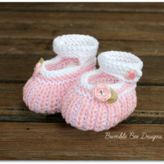 100% Cotton Hand Knitted Baby Girl Booties in Pink and White with Ribbon flower.