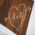 Hand-stitched Tree Carving: your initials 'carved' in a love heart on wood paper