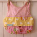 Reversible Bib - pink and yellow fairytale trees and castles