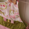Reversible Bib - pastel pink and green zoo