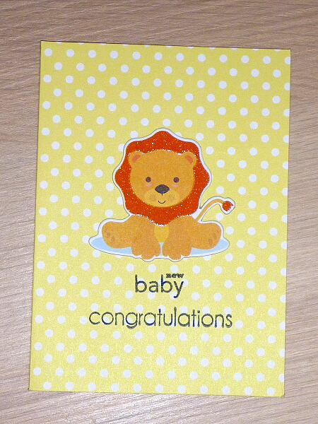 Yellow and white New baby congratulations card with adorable lion