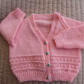 SIZE 18 mths -2 yrs Hand knitted cardigan in peachy pink: washable