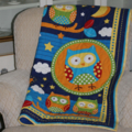 Kid's bright quilt featuring Owls