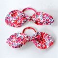 Elastic hair tie with a Liberty fabric bow. Cranberries