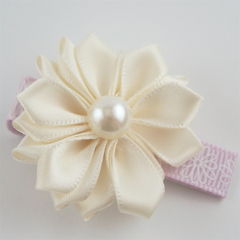 Sweet Cream satin flower hair clip.