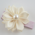 Sweet Cream satin flower hair clip.