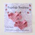 Pair of pink ribbon hearts hair clips