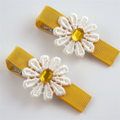 Beautiful pair of  lace daisy clips.