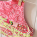 Reversible Bib - patchwork, pink and lime green with ribbon taggies