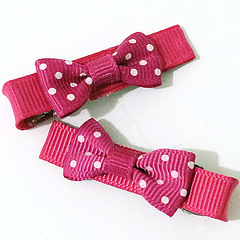 Super Sweet Pair of hot pink and white polka dot bows.