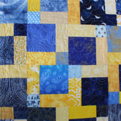 Sunshine yellows and vivid blues - patchwork quilt measures 66 inches square