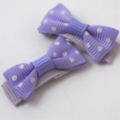 Pair of lilac and white polka bow baby snap hair clips
