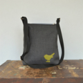 Across body handbag. Quality upholstery fabric with leather bird detail. Zip
