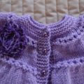 Size 0 - 6 months : Baby jacket/cardigan in purple with detachable rosette