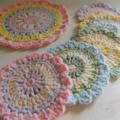 5 set of Crocheted Coasters and Potholder set.