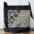 Black bag with beige floral double front pocket   crossbody handbag