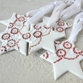 Porcelain Christmas decorations. Red and white stars. Ceramic. Ornaments.