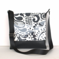 Black vinyl messenger bag with PVC coverered front flap
