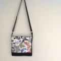 Black canvas messenger with butterfly vinyl covered flap