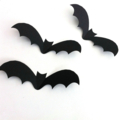 Halloween Bat shapes, cut-outs. Black 3D bats, Spooky holiday party decorations.