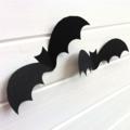 Halloween Bat shapes, cut-outs. Black 3D bats, Spooky holiday party decorations.