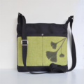 The 'Sabina' bag. Black with green pocket, features green suede Ginkgo leaves