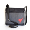 The 'Sabina' bag. Stylish black with a little red robin stitched.