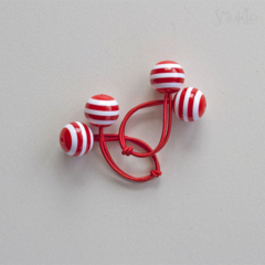 Hair ties. Elastic hair ties. Funky. Red and white stripes. Retro style.