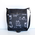 Black long strapped bag featuring black fabric with white owls