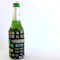 Reversible Bottle Cuff - Computer USB ports on Black with blue crosshatch
