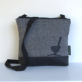 The 'Jodi' bag Large, Pewter fabric with black upholstery vinyl and bird motif.