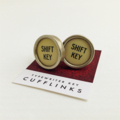 Typewriter-key cufflinks - circular ivory SHIFT KEY keys