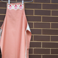 Apron with cupcakes patchwork applique. Waterproof.