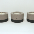Set of three concrete tealight candle holders, round, black