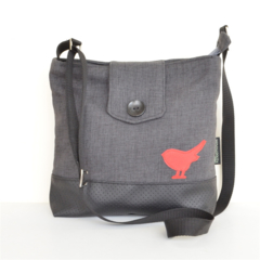 Black, charcoal bag with a red robin bird detail.